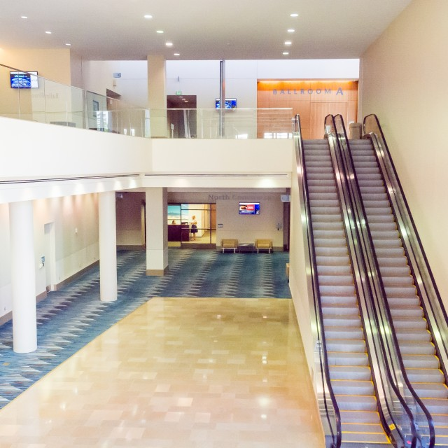 Interior photo from the 2nd floor north concourse facing the escalators leading up to the ballroom a