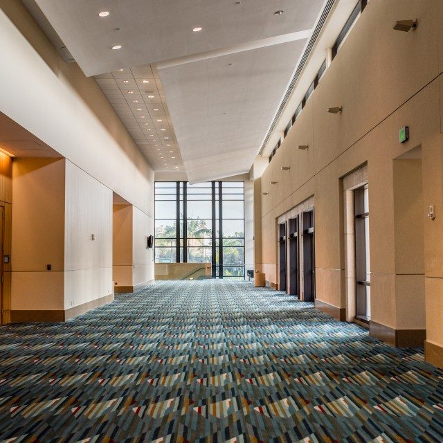 Interior photo of the Ballroom ABC prefunction space facing north from the top of the escalator