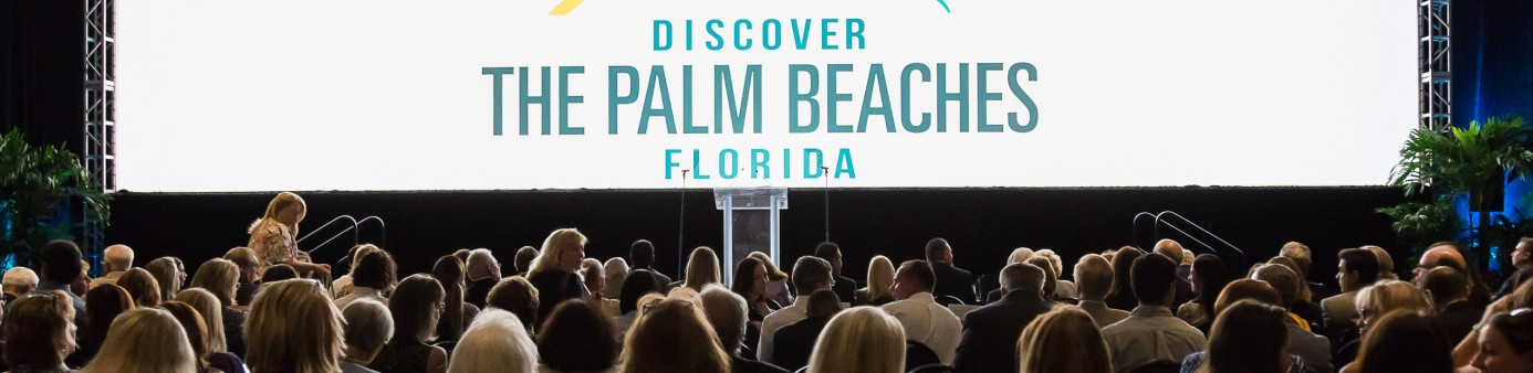 Photo of large wide screen with Discover the Palm Beaches logo