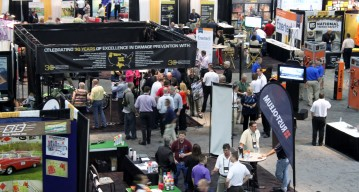 Aerial photo of exhibit set-up with booths and attendees