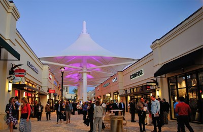 Photo of the Palm Beach outlets looking down an aisle where an awning covers the walkway